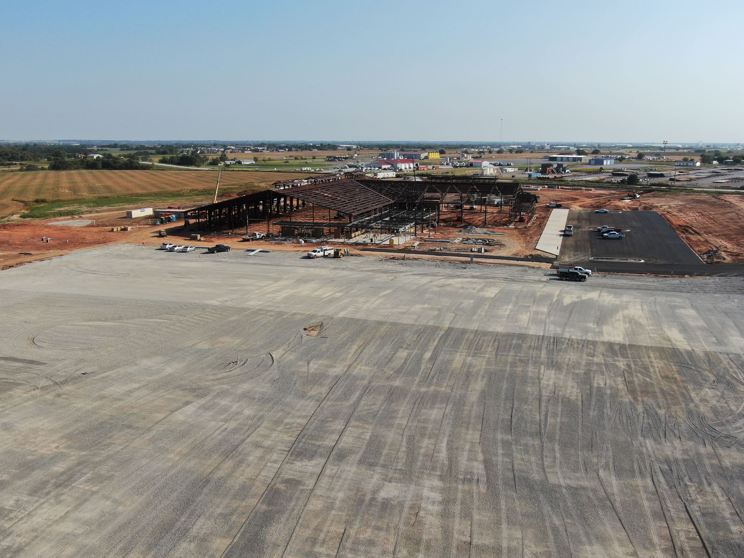 Drone shot looking North East over future vendor parking, which has been graveled in this picture.