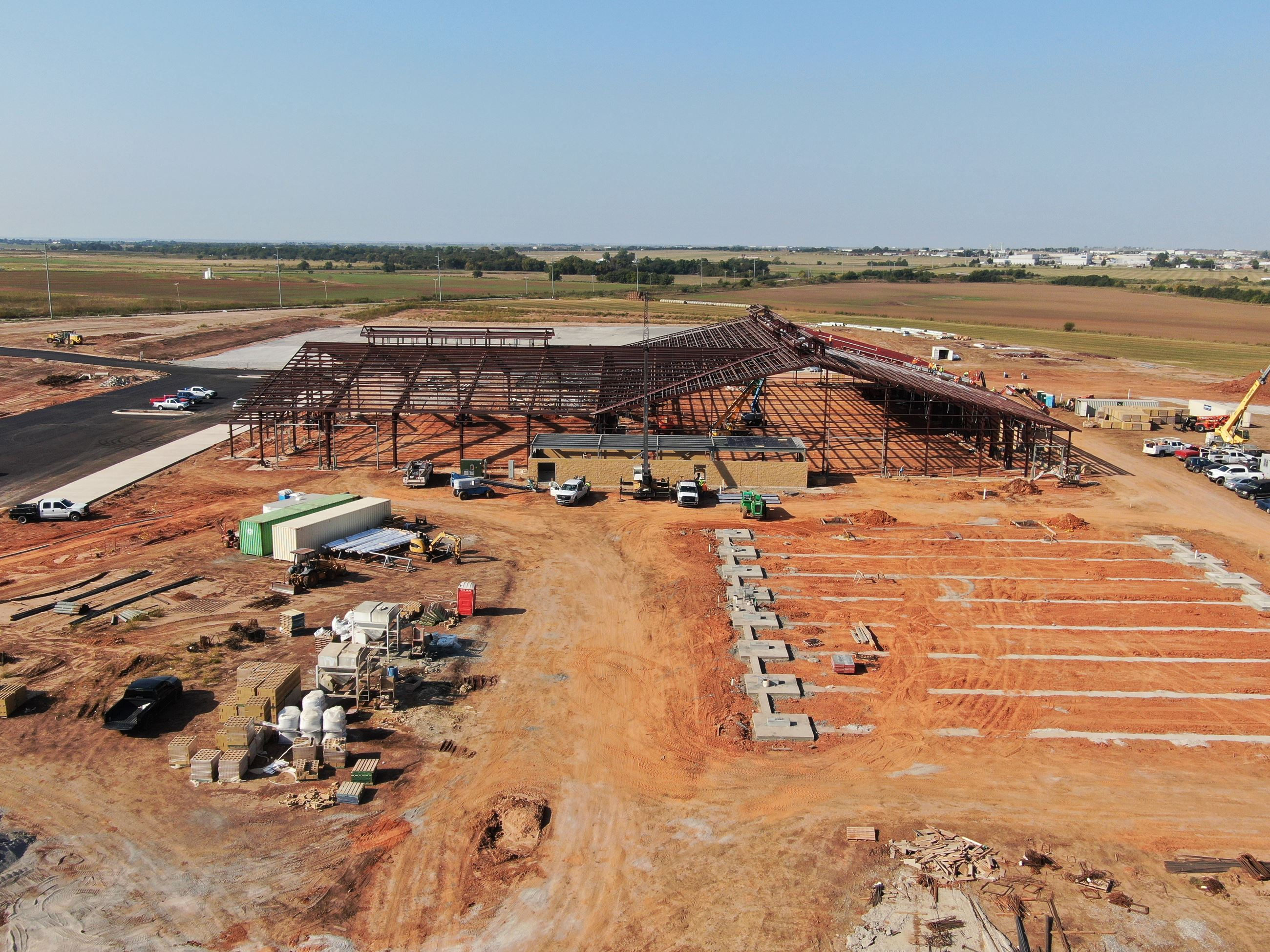 Drone shot looking South West over construction of Barn, Expo Hall, and Arena